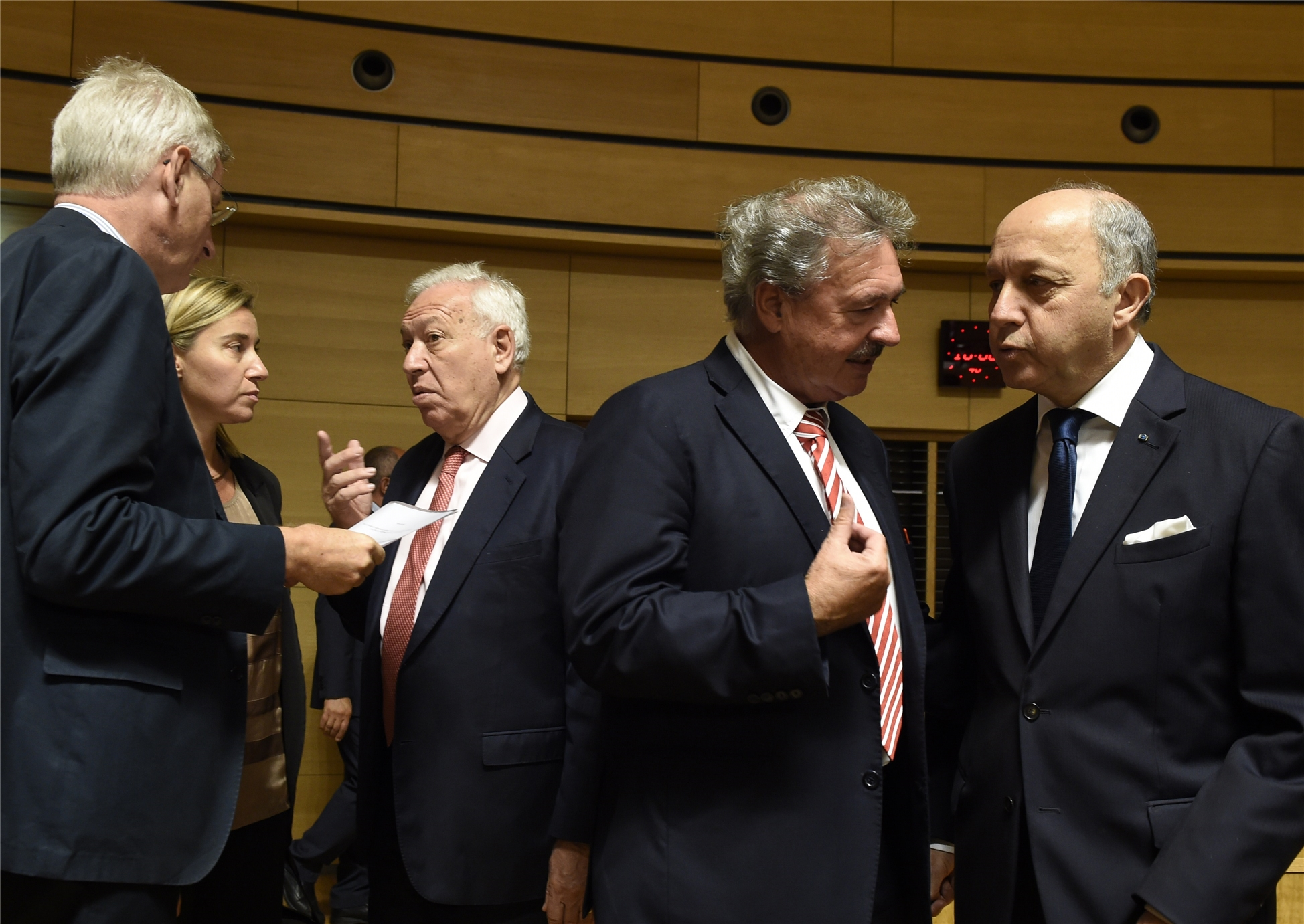 Luxebourg Foreign minister Jean Asselborn (2ndR) talks with French Foreign Affairs minister Laurent Fabius (R) during a Foreign Affairs Council meeting in Luxembourg on June, 23 2014