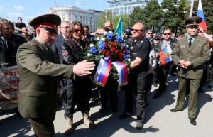 Members and supporters of the Russian motorcycle club Night Wolves attend a wreath laying ceremony in front of the heroes' monument of the Red Army in downtown Vienna, Austria, Friday, May 6, 2016. (AP Photo/Ronald Zak)