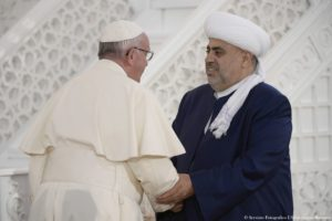 """This handout picture released by the Vatican press office shows Pope Francis and Sheik Allahshukur Pashazadeh (R), Grand Mufti of the Caucasus, on October 2, 2016 at the Heydar Aliyev Mosque during a meeting with representatives of religious communities of Azerbaijan. RESTRICTED TO EDITORIAL USE - MANDATORY CREDIT """"AFP PHOTO / OSSERVATORE ROMANO"""" - NO MARKETING NO ADVERTISING CAMPAIGNS - DISTRIBUTED AS A SERVICE TO CLIENTS / AFP / OSSERVATORE ROMANO / HO / RESTRICTED TO EDITORIAL USE - MANDATORY CREDIT """"AFP PHOTO / OSSERVATORE ROMANO"""" - NO MARKETING NO ADVERTISING CAMPAIGNS - DISTRIBUTED AS A SERVICE TO CLIENTS"""